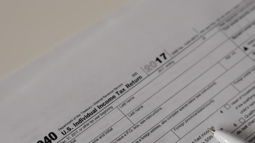 Income Tax Return Refund Forms 1040 On White Desk Movement
