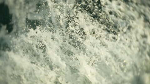 engine propellers churn the water in waves and wakes. The spray of water from the ship's propellers in the open sea. 4k, close-up