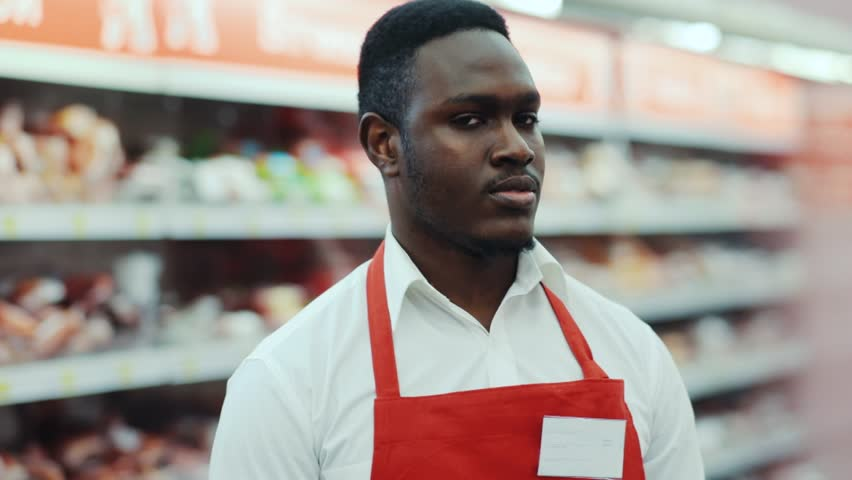 Portrait handsome happy african american sales consultant smile look at camera in supermarket market happy salesperson store black food seller shop grocery holding job organic market staff