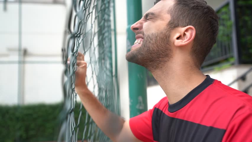 Fan Watching a Game at bleachers fence | Shutterstock HD Video #1008769988