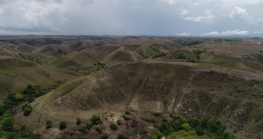 Aerial View of Wavy Green Savanna Mamboro, Sumba Island, Indonesia    Shutterstock HD Video #1008775358