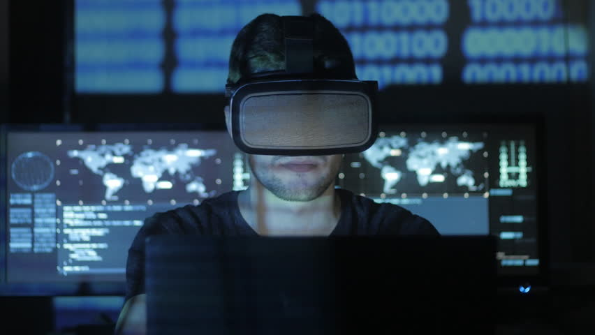 Man hacker programmer uses a virtual reality helmet for programming. IT Technologies of the Future.   Shutterstock HD Video #1008776858