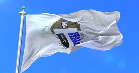 Tulsa city flag, city of USA or United States of America, waving at wind in blue sky, slow - loop