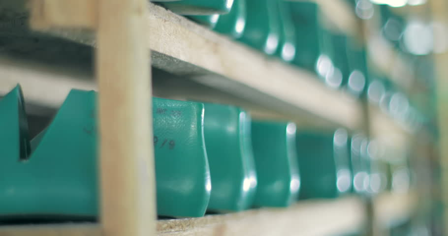 Shoe Production Factory. shoe pads of different sizes are on the shelves. tracking shot. tracking shot