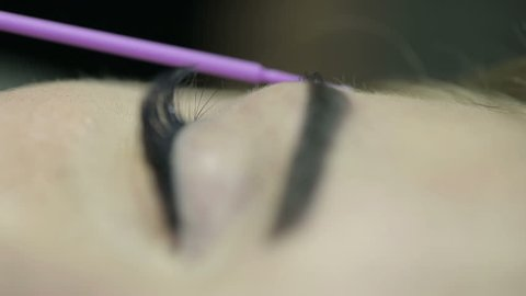 Close up of cosmetologist making permanent makeup.Microblading procedure.