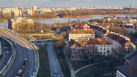 WARSAW, POLAND - FEBRUARY 18 2018: 4K Timelapse ZOOM OUT: a Panoramic view of the bridge through the Vistula and the right bank of Warsaw (Praga district) on Roman Catholic Cathedral Pw. St. Florian