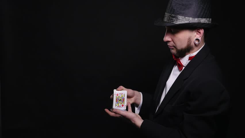 Magic, card tricks, gambling, casino, poker concept - man showing trick with playing cards | Shutterstock HD Video #1008822368