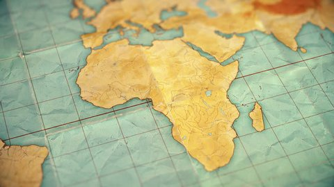 Zoom in from World Map to Africa. Old well used world map with crumpled paper and distressed folds. Vintage sepia colors. Blank version