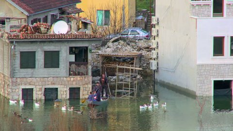 MONTENEGRO - RIJEKA CRNOJEVICA - DECEMBER, 2012 - People in flooded areas
