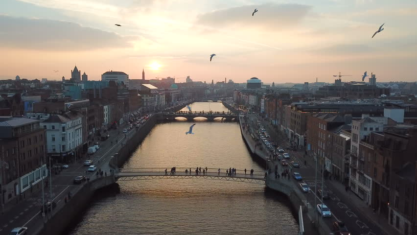 Aerial view of city center of Dublin with river Liffey during sunset