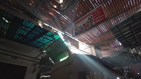 Flare and light rays in the souk of Marrakech Morocco where people sell typical and traditional home made commodities slow motion side