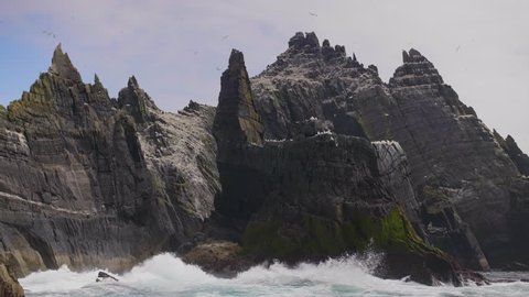 Skellig Michael Island And Waves Crashing On Its Rocky Shore