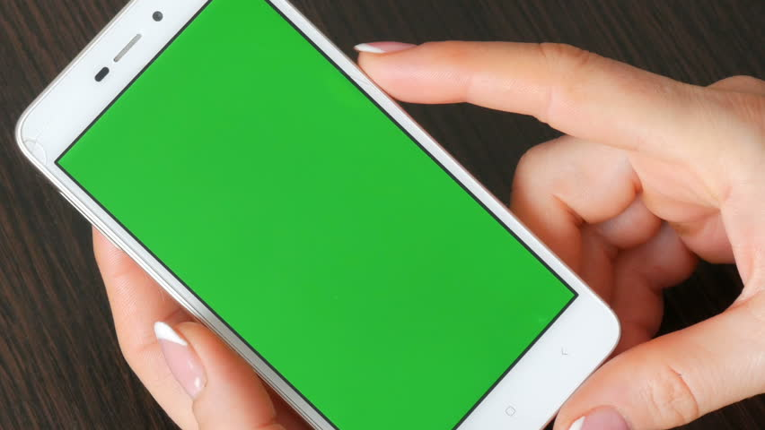 Female hands with beautiful French manicure take white smartphone with Green Screen. Using Smartphone,Holding Smartphone with Green Screen #1008930578