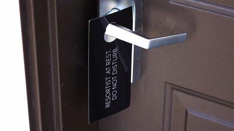 Professional video of do not disturb door sign