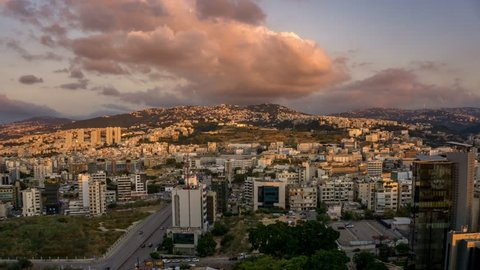 City cinemagraph of Beirut, Lebanon at sunset looking from the harbour east to the hills in an infinite and seemless loop