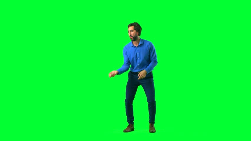 young crazy man dancing against chroma key background