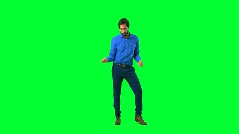 young man dancing against chroma key background