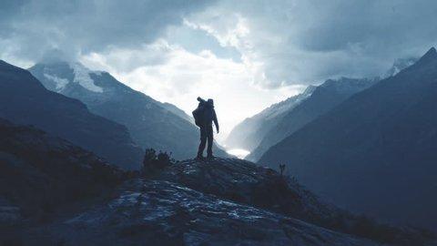 Silhouette of a mountaineer walking in the edge of summit, Santa cruz Trek, Peru. Slow motion.