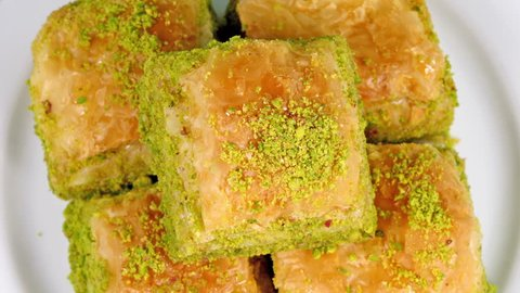 Baklava on a dessert plate rotating