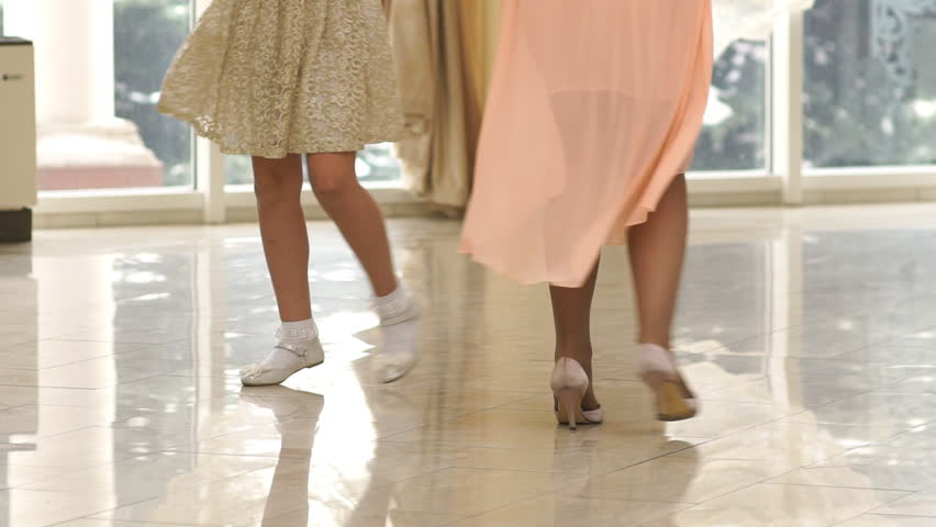 Mother and daughter holding hands and spinning together | Shutterstock HD Video #1009032518