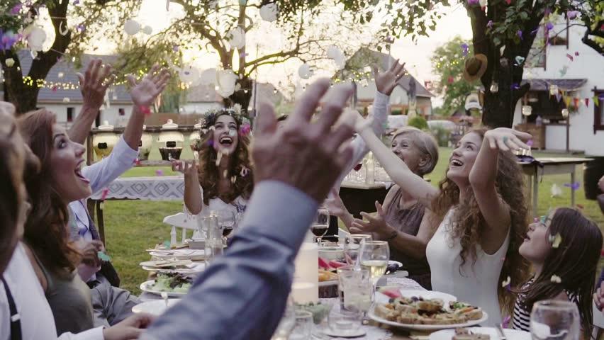 Wedding reception outside in the backyard. | Shutterstock HD Video #1009063388