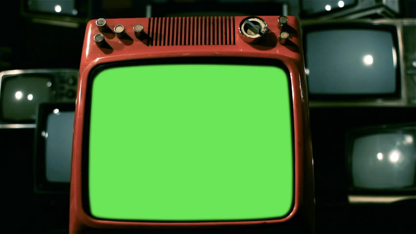 "A Vintage Red Television with Green Screen over Many Retro TVs from the 80s and 90s. Dolly Shot. You can Replace Green Screen with the Footage or Picture you Want with ""Keying"" effect in AE. 