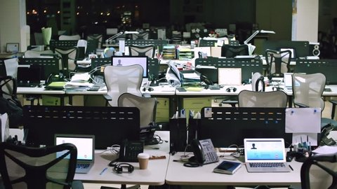 PAN of empty helpline office at night