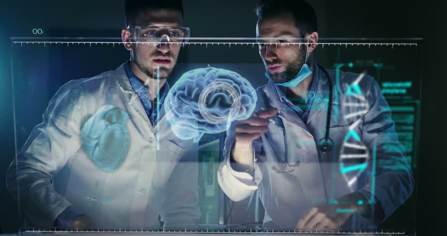 A couple of doctors or scientist analyze the patient's medical situation by checking on a glass monitor with a futuristic holography. Concept of: medicine, doctors, future, holography. #1009087268