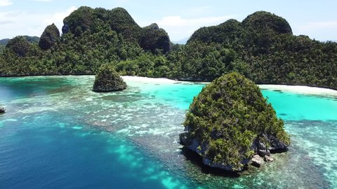 Limestone islands, fringed by corals, are found in an idyllic, tropical lagoon in Wayag, Raja Ampat, Indonesia. This unique, equatorial region is best known for its vast array of marine biodiversity.