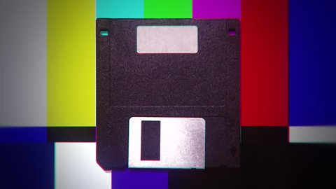 A floppy disk over a changing colorful background. Dubstep distorted colors.