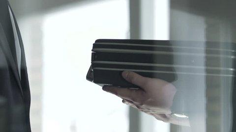 Politician checking dollar bills cash in open briefcase, bribe money offering