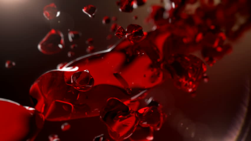 Wine is pouring in slow motion. Splash of alcohol, red wine.