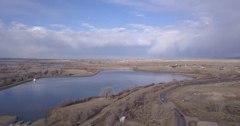 We fly to the northwest over the Platte Canyon Reservoir in Littleton CO exposing a glass like surface overlooking a far reaching prairie