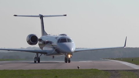 Executive jet taxiiing onto the runway at Oxford Airport. This airfield is used extensively for business and private avaiation.