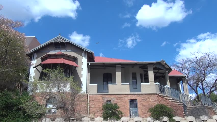 HD high quality summer day video footage of attractive old vintage colonial style German house near historical center of Windhoek, the capital of Namibia, southern Africa