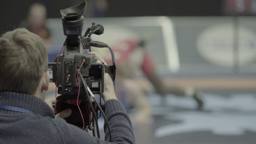 Cameraman with a camera while shooting sports. Media, news, press, TV (man, male) | Shutterstock HD Video #1009233308