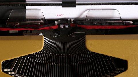 """Typing """"KGB CASE"""" on an old typewriter"""