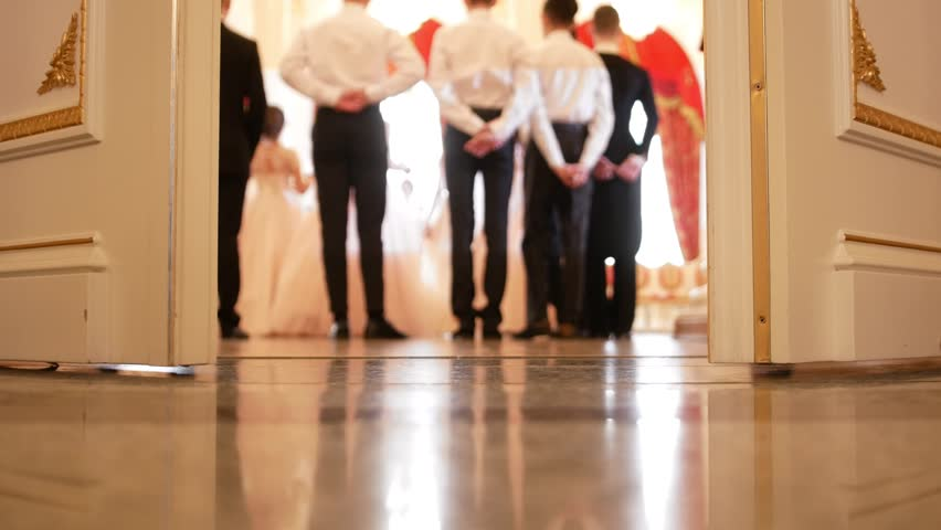 Young men and ladies in fluffy dresses dancing waltz