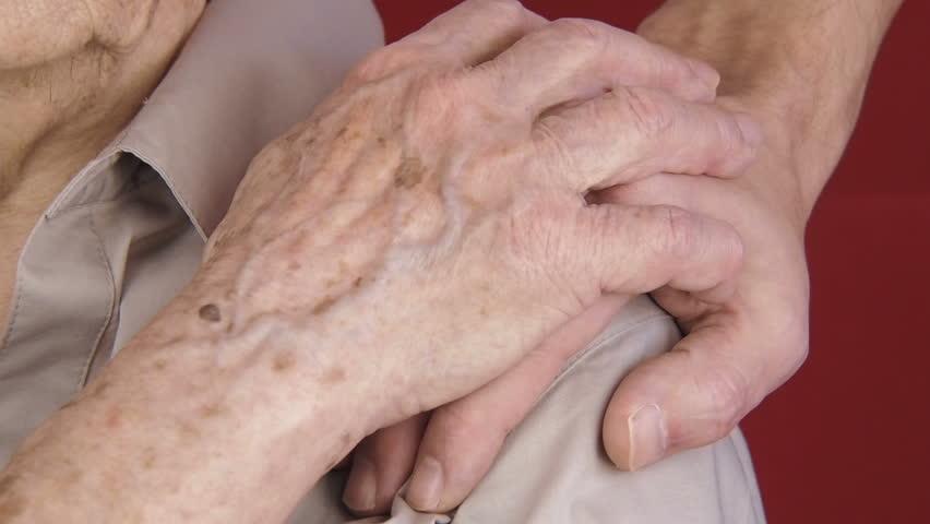 Help the elderly. Hands of the elderly. Hand on the shoulder of the elderly.