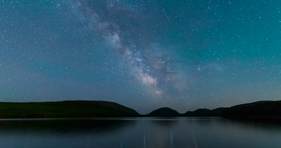 The Milky Way Galaxy passes over Eagle Lake in Acadia National Park, Maine.
