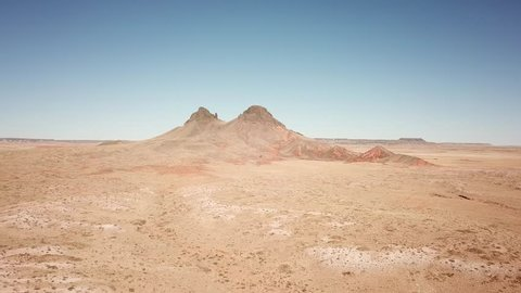 Fly through the Arizona desert towards a beautiful mountain in the middle of nowhere. Red and yellow tones all around, mars looking landscape!