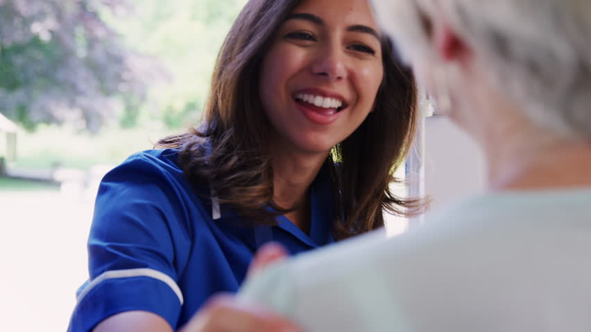 Female care worker on home visit, close up
