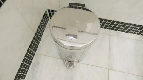 Throwing tissue in bathroom bin in 60 fps
