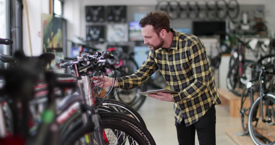 Portrait of a small business owner using digital tablet in a cycle store   Shutterstock HD Video #1009422608