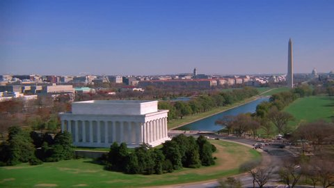 WASHINGTON DC - CIRCA 1990s - 1990s - Beautiful aerial over the Lincoln Memorial in Washington D.C. with Washington Monument background.