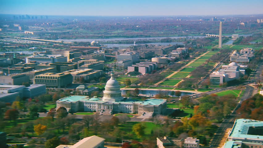 WASHINGTON DC - CIRCA 1990s - 1990s - Good aerial over capitol dome, Congress and Washington Monument in Washington D.C.