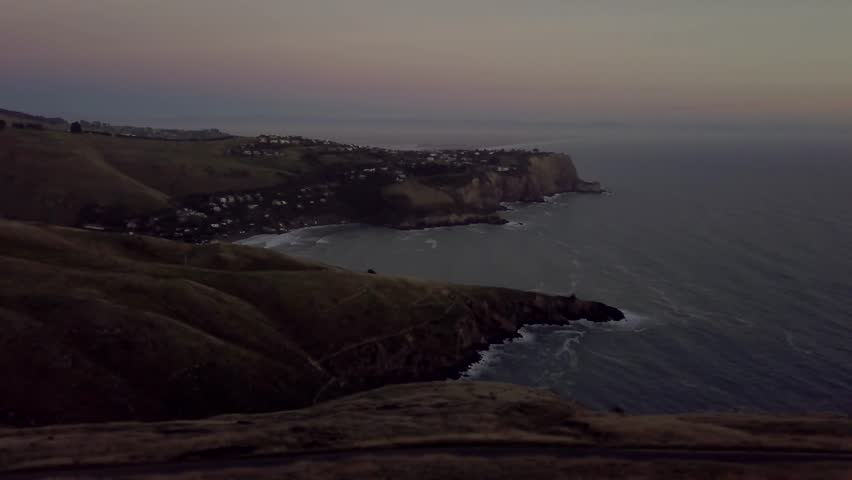 Coast of New Zealand shot by drone during sunrise or sunset in autumn season. Scenic and pristine nature | Shutterstock HD Video #1009448378