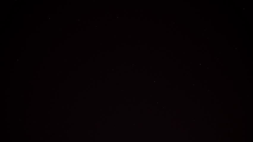 Stars and satellites in the clear dark sky pass slowly. Their lights are clearly visible. Time lapse shot. | Shutterstock HD Video #1009467488