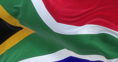 Loopable full screen South African flag is waving in slow motion. 3d rendering.