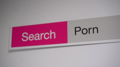 Porn - browser search query online, typing in the search term into Internet. Search web form, tablet screen shot close up.